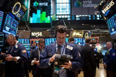 Traders work on the floor of the New York Stock Exchange March 17, 2014. REUTERS/Brendan McDermid