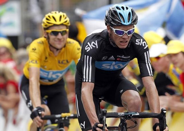 Sky Procycling rider and wearer of the leader's yellow jersey Bradley Wiggins of Britain (L) and teammate and compatriot Christopher Froome (R) arrive at the finish line of the 17th stage of the 99th Tour de France cycling race between Bagneres-de-Luchon and Peyragudes, July 19, 2012.       REUTERS/Stephane Mahe