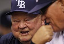Tampa Bay Rays senior baseball advisor Don Zimmer (L) laughs with manager Joe Maddon before their MLB American League baseball game against the Toronto Blue Jays in St. Petersburg, Florida September 1, 2010. REUTERS/Scott Audette