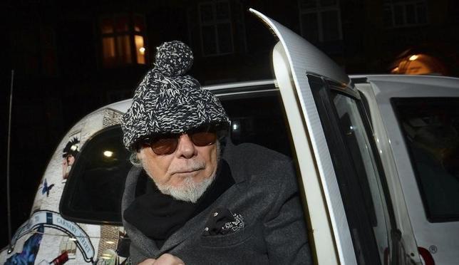 Former British pop star Gary Glitter returns to his home in London October 28, 2012.  REUTERS/Paul Hackett