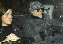 Former British pop star Gary Glitter (R) returns in a taxi to his home in London October 28, 2012. REUTERS/Paul Hackett
