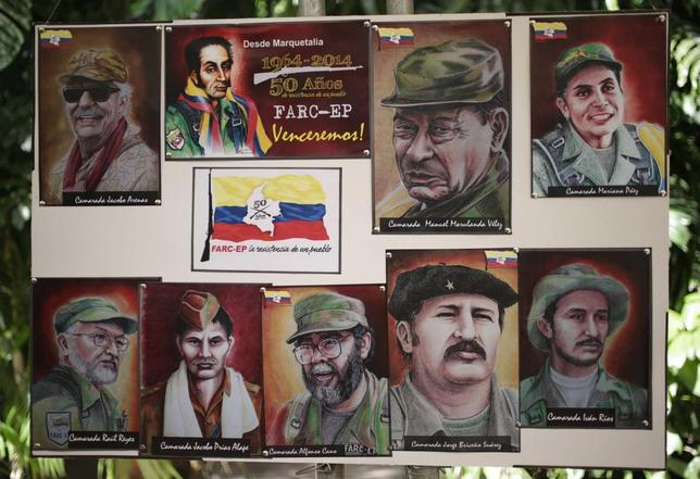 Paintings of the founders of Colombia's guerrilla group, the FARC, are seen during a news conference in Havana May 27, 2014.  REUTERS/Enrique De La Osa