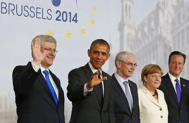 (L-R) Canada's Prime Minister Stephen Harper, U.S. President Barack Obama, European Council President Herman Van Rompuy, Germany's Chancellor Angela Merkel and Britain's Prime Minister David Cameron pose for a group photo during a G7 leaders meeting at European Council headquarters in Brussels June 5, 2014.   REUTERS/Yves Herman