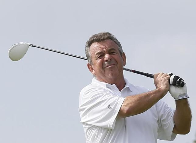 Tony Jacklin of England tees off on the first hole during the first round of the Mission Hills World Celebrity Pro-Am golf tournament in Haikou, China's Hainan province October 20, 2012 file photo. REUTERS/Tyrone Siu