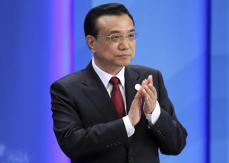 Chinese Premier Li Keqiang claps as he attends the opening ceremony of the Boao Forum for Asia (BFA) Annual Conference 2014 in Boao, Hainan province April 10, 2014 . REUTERS/China Daily