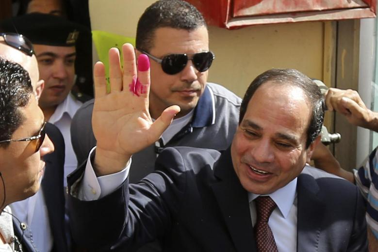 Presidential candidate and former army chief Abdel Fattah al-Sisi gestures after casting his ballot in Cairo, May 26, 2014. REUTERS/Amr Abdallah Dalsh