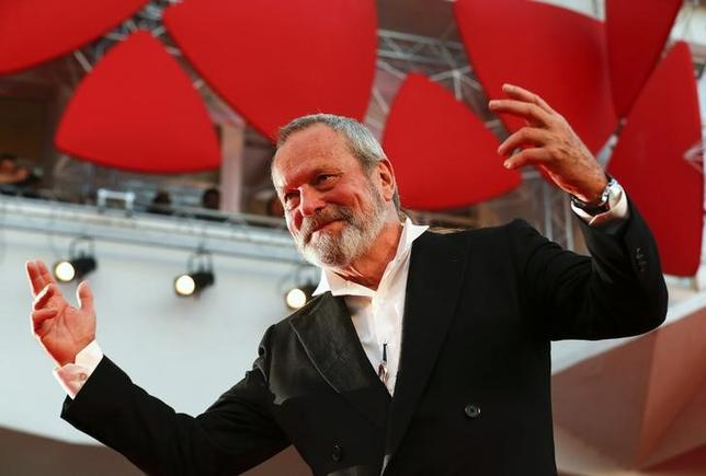Director Terry Gilliam gestures on the red carpet for his movie ''The Zero Theorem'' at the 70th Venice Film Festival in Venice September 2, 2013. REUTERS/Alessandro Bianchi