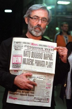 Slavko Curuvija, the owner and editor-in-chief of Dnevni Telegraf, shows the disputed issue of his newspaper in Belgrade early October 14, 1998.