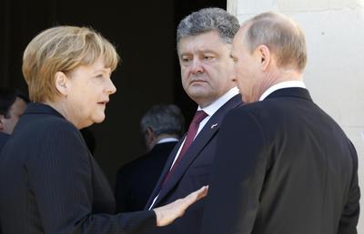 Putin, Ukraine leader break crisis ice at D-Day event
