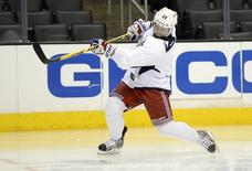 Jun 6, 2014; Los Angeles, CA, USA; New York Rangers right wing Martin St. Louis shoots during practice the day before game two of the 2014 Stanley Cup Final against the Los Angeles Kings at Staples Center. Mandatory Credit: Jerry Lai-USA TODAY Sports