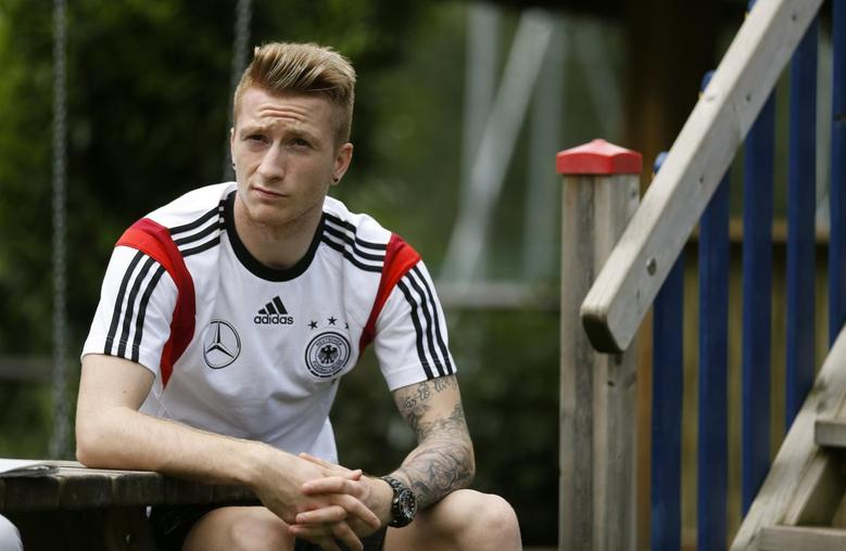German national soccer player Marco Reus listens during a media day at Hotel Andreus in St. Martin, northern Italy, May 25, 2014.   REUTERS/Ina Fassbender