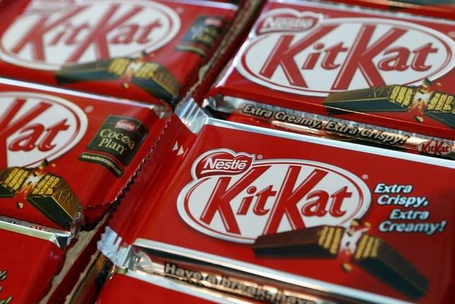 A Nestle logo is pictured on KitKat chocolate bars at the company headquarters in Vevey October 17, 2013.  REUTERS/Denis Balibouse