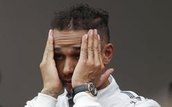 Mercedes Formula One driver Lewis Hamilton of Britain reacts on the podium after taking the second place in the Monaco Grand Prix in Monaco May 25, 2014.        REUTERS/Max Rossi