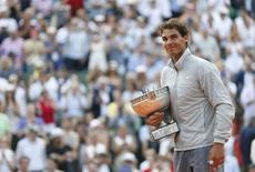 Rafael Nadal of Spain attends the trophy ceremony after defeating Novak Djokovic of Serbia during their men's singles final match to win the French Open Tennis tournament at the Roland Garros stadium in Paris June 8, 2014.    REUTERS/Vincent Kessler