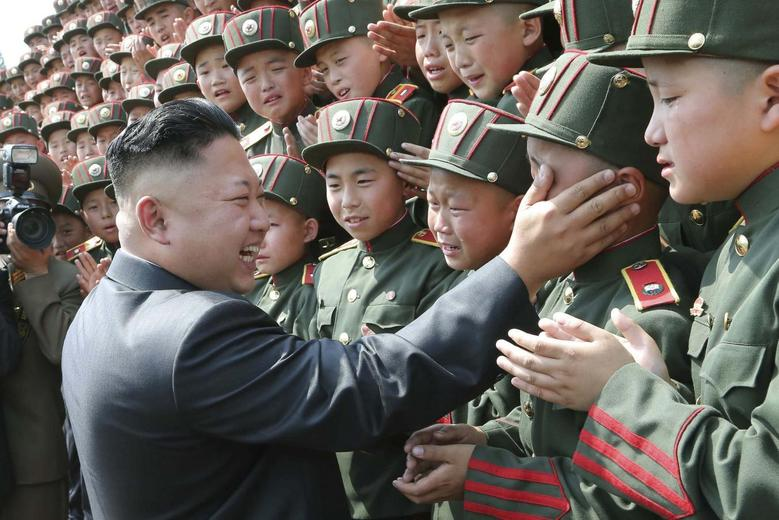 North Korean leader Kim Jong Un visits Mangyongdae Revolutionary School on the occasion of the 68th anniversary of the founding of the Korean Children's Union (KCU) in this undated photo released by North Korea's Korean Central News Agency (KCNA) in Pyongyang June 7, 2014. REUTERS/KCNA (NORTH KOREA - Tags: POLITICS IMAGES OF THE DAY)