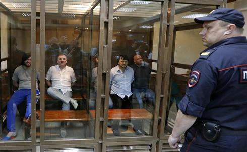 Five jailed for murder of Russian reporter, but son asks: on whose orders?