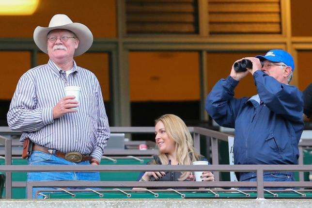 Jun 4, 2014; Elmont, NY, USA; California Chrome co owner Steve Coburn (left) and trainer Art Sherman view the morning workout in preparation for the 2014 Belmont Stakes at Belmont Park.  Anthony Gruppuso-USA TODAY Sports