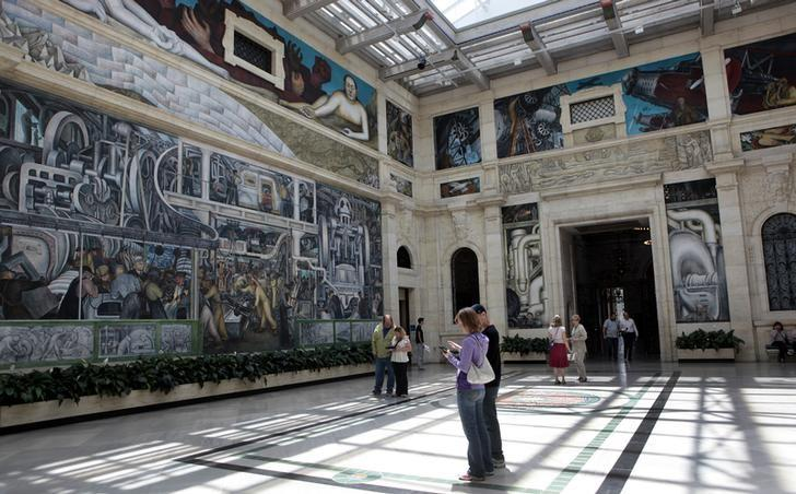 Visitors to the Detroit Institute of Arts look at the four-wall mural by famed artist Diego Rivera in Detroit, Michigan June 5, 2013. REUTERS/Rebecca Cook