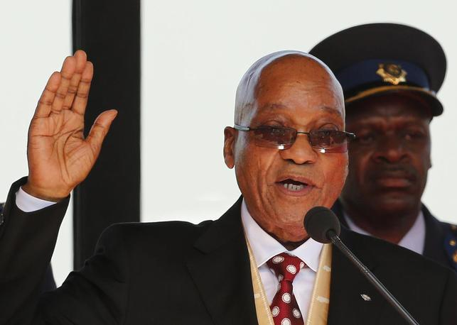 South African President Jacob Zuma takes his oath of office during his inauguration ceremony at the Union Buildings in Pretoria May 24, 2014. REUTERS/Siphiwe Sibeko