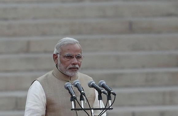 Prime Minister Narendra Modi takes his oath at Rashtrapati Bhavan in New Delhi May 26, 2014. REUTERS/Adnan Abidi