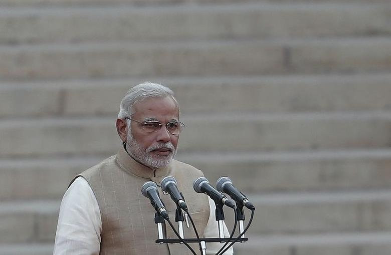 Prime Minister Narendra Modi takes his oath at Rashtrapati Bhavan in New Delhi May 26, 2014. REUTERS/Adnan Abidi