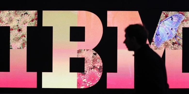 A man passes by an illuminated IBM logo at the CeBIT computer fair in Hanover February 27, 2011 file photo. REUTERS/Tobias Schwarz