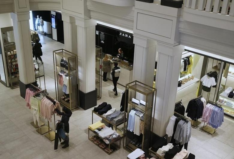 People walk inside a Zara store in central Madrid March 18, 2014. REUTERS/Andrea Comas