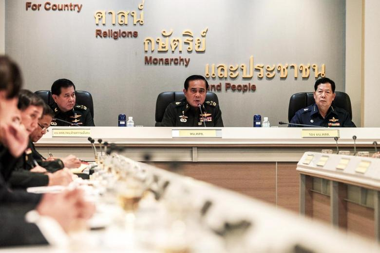 Thai Army chief General Prayuth Chan-ocha speaks during a meeting with Thai ambassadors at the Royal Thai Army Headquarters in Bangkok June 11, 2014. REUTERS/Chanat Katanyu/Pool
