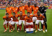 (Back L to R) Daryl Janmaat, Daley Blind, Stefan de Vrij, Terence Kongolo, Bruno Martins Indi, goalkeeper Jasper Cillessen and (front L to R) Joel Veltman, Memphis Depay, Jordi Clasie, Robin van Persie, and Georginio Wijnaldum pose before their international soccer friendly match against Ecuador in the Amsterdam Arena in this May 17, 2014 file photo. The Netherlands squad will meet Spain, Australia and Chile in Group B of the World Cup finals in Brazil. REUTERS/Michael Kooren/Files (NETHERLANDS - Tags: SPORT SOCCER)