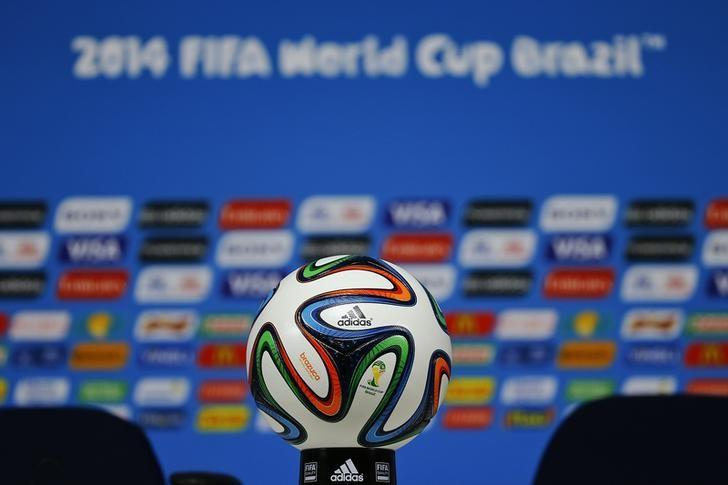 The official match ball for the 2014 World Cup, the ''Brazuca'' , is displayed on the table before a news conference at the Corinthians arena in Sao Paulo June 11, 2014.    REUTERS/Damir Sagolj
