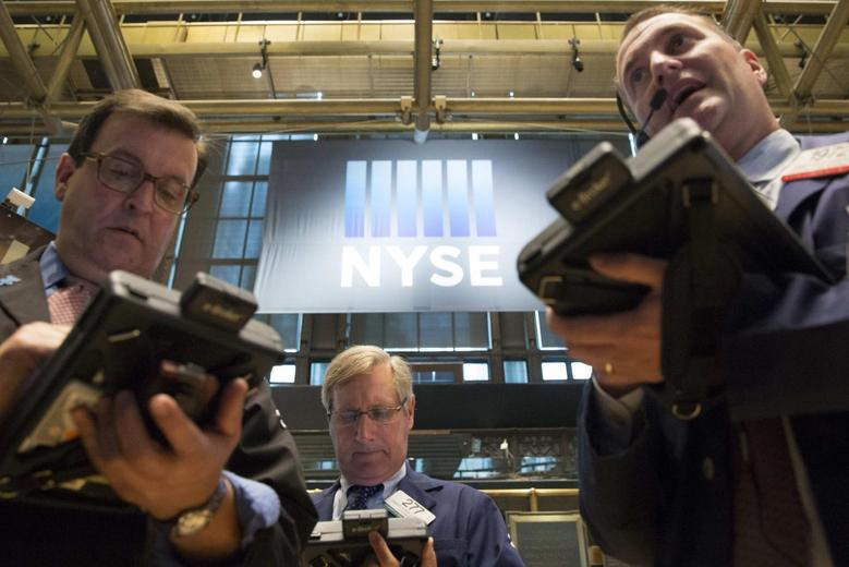 Traders work on the floor of the New York Stock Exchange June 10, 2014. REUTERS/Brendan McDermid