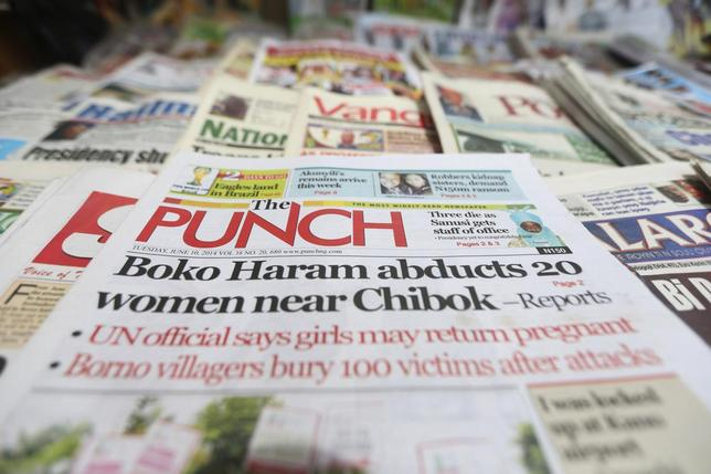 A newspaper with its frontpage headline on an abduction of women from a village in northeast Nigeria, is displayed at a vendor's stand along a road in Ikoyi district in Lagos June 10, 2014. REUTERS/Akintunde Akinleye