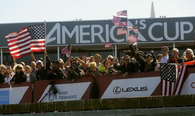 Fans of Oracle Team USA cheer after their team defeated Emirates Team New Zealand during Race 18 of the 34th America's Cup yacht sailing race in San Francisco, California September 24, 2013. REUTERS/Robert Galbraith