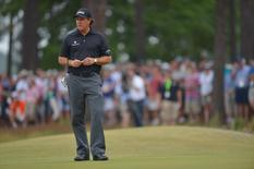 Jun 12, 2014; Pinehurst, NC, USA;  Phil Mickelson looks on at the 14th hole during the first round of the 2014 U.S. Open golf tournament at Pinehurst Resort Country Club - #2 Course. Kevin Liles-USA TODAY Sports