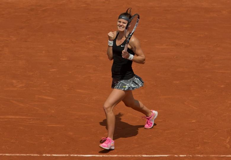 May 31, 2014; Paris, France; Lucie Safarova (CZE) celebrates recording match point during her match against Ana Ivanovic (SRB) on day seven at the 2014 French Open at Roland Garros. Susan Mullane-USA TODAY Sports