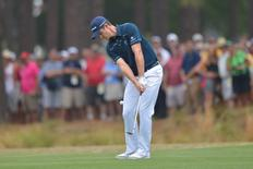 Jun 12, 2014; Pinehurst, NC, USA; Justin Rose chips on the 14th hole during the first round of the 2014 U.S. Open golf tournament at Pinehurst Resort Country Club - #2 Course. Kevin Liles-USA TODAY Sports