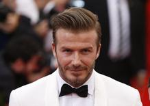 "Soccer star David Beckham arrives at the Metropolitan Museum of Art Costume Institute Gala Benefit celebrating the opening of ""Charles James: Beyond Fashion"" in Upper Manhattan, New York, May 5, 2014 FILE PHOTO.  REUTERS/Lucas Jackson/Files"
