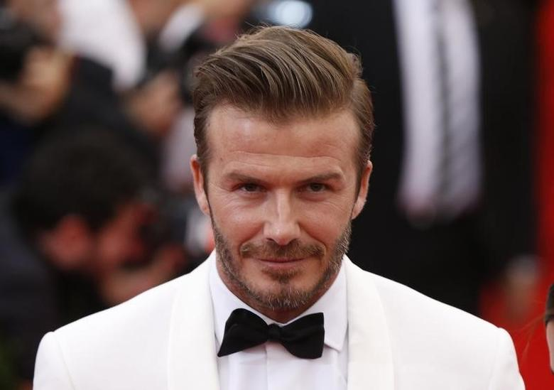 Soccer star David Beckham arrives at the Metropolitan Museum of Art Costume Institute Gala Benefit celebrating the opening of ''Charles James: Beyond Fashion'' in Upper Manhattan, New York, May 5, 2014 FILE PHOTO.  REUTERS/Lucas Jackson/Files