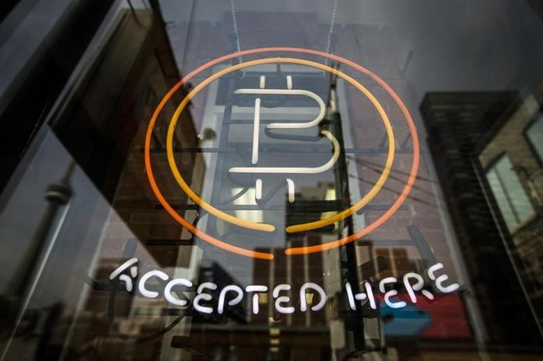 A Bitcoin sign is seen in a window in Toronto, May 8, 2014.    REUTERS/Mark Blinch/Files