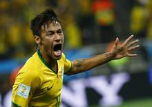 Brazil's Neymar celebrates his goal against Croatia during their 2014 World Cup opening match at the Corinthians arena in Sao Paulo June 12, 2014. REUTERS/Damir Sagolj