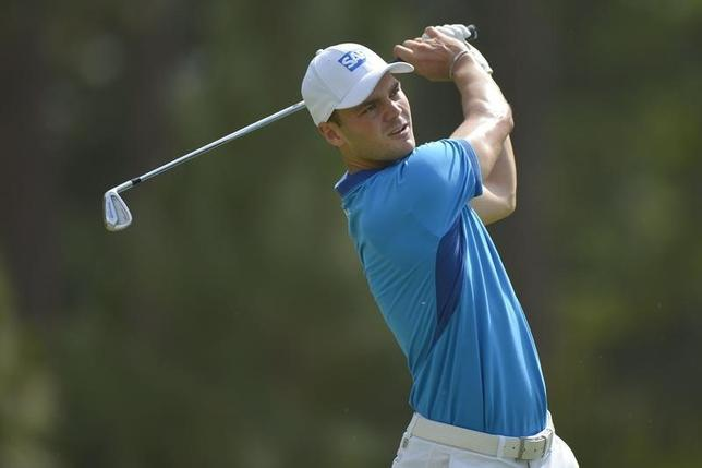Jun 12, 2014; Pinehurst, NC, USA; Martin Kaymer tees off on the 9th hole during the first round of the 2014 U.S. Open golf tournament at Pinehurst Resort Country Club - #2 Course. Mandatory Credit: Kevin Liles-USA TODAY Sports