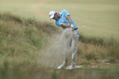 Jun 12, 2014; Pinehurst, NC, USA;  Adam Scott hits a shot on the 10th hole during the first round of the 2014 U.S. Open golf tournament at Pinehurst Resort Country Club - #2 Course. Jason Getz-USA TODAY Sports