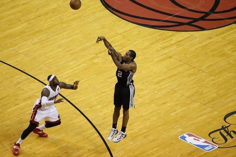 Jun 12, 2014; Miami, FL, USA; San Antonio Spurs forward Kawhi Leonard (2) shoots as Miami Heat forward LeBron James (6) defends during the third quarter of game four of the 2014 NBA Finals at American Airlines Arena. Mandatory Credit: Robert Mayer-USA TODAY Sports - RTR3TIYA