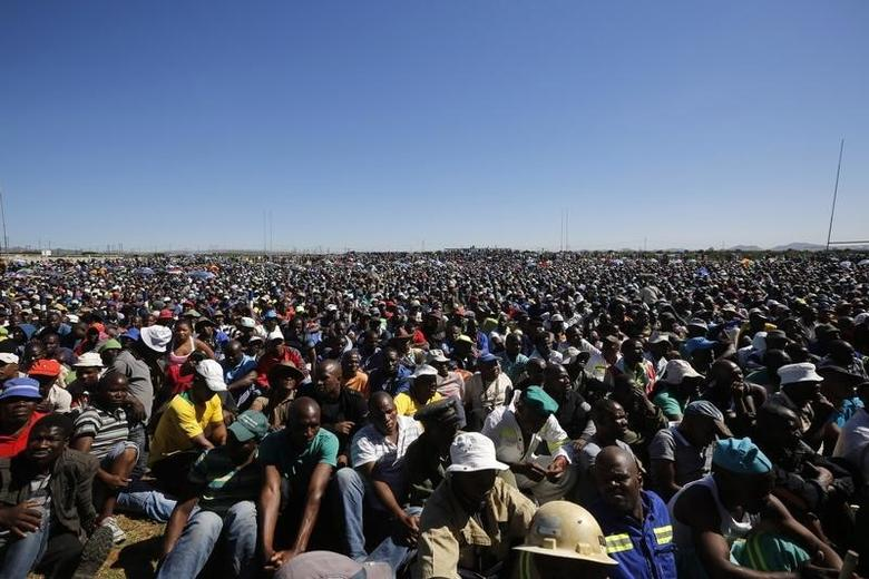 Striking platinum miners attend a rally near Lonmin's Marikana mine April 29, 2014. REUTERS/Mike Hutchings