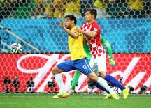 Brazil forward Fred (9) battles for the ball with Croatia defender Dejan Lovren in the second half during the opening game of the 2014 World Cup at Arena Corinthians. Brazil defeated Croatia 3-1. Mark J. Rebilas-USA TODAY Sports