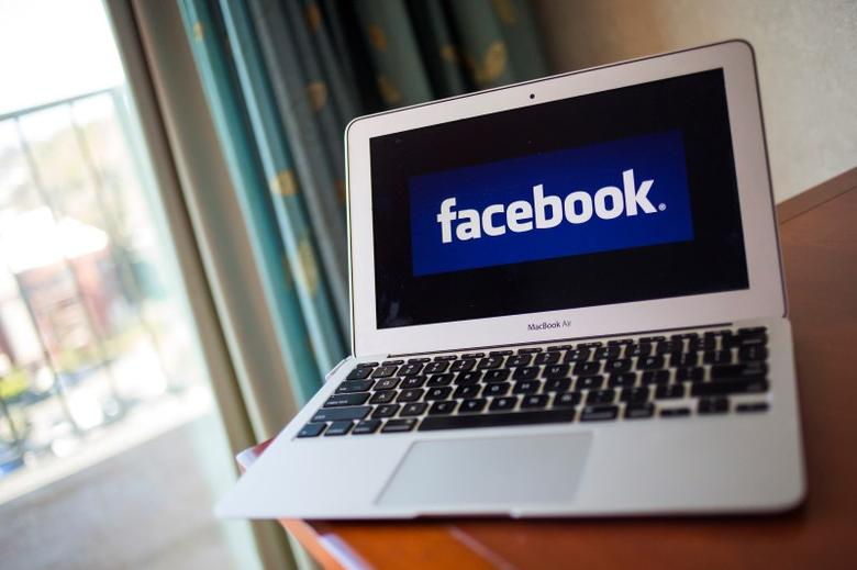 A portrait of the Facebook logo in Ventura, California December 21, 2013. REUTERS/Eric Thayer/Files