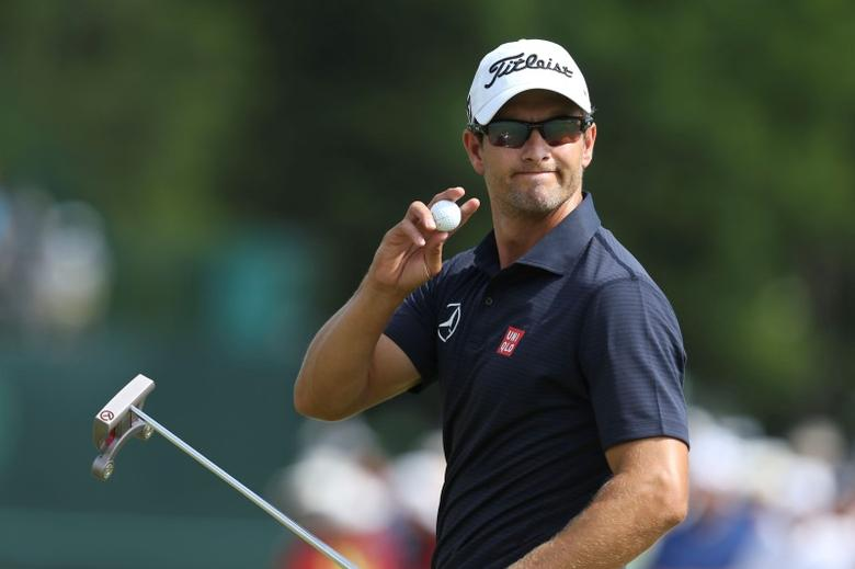 Jun 13, 2014; Pinehurst, NC, USA;  Adam Scott acknowledges the crowd after making his putt on the 18th hole during the second round of the 2014 U.S. Open golf tournament at Pinehurst Resort Country Club - #2 Course. Jason Getz-USA TODAY Sports
