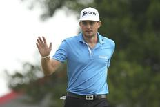 Jun 13, 2014; Pinehurst, NC, USA;  Keegan Bradley acknowledges the crowd after making a putt on the 13th green during the second round of the 2014 U.S. Open golf tournament at Pinehurst Resort Country Club - #2 Course. Jason Getz-USA TODAY Sports