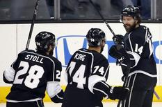 Los Angeles Kings' Justin Williams (R) celebrates his goal against the New York Rangers with teammates Dwight King (C) and Jarret Stoll during the first period in Game 5 of their NHL Stanley Cup Finals hockey series in Los Angeles, California, June 13, 2014. REUTERS/Lucy Nicholson