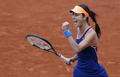 Ana Ivanovic of Serbia reacts after winning her women's singles match against Elina Svitolina of Ukraine at the French Open tennis tournament at the Roland Garros stadium in Paris May 29, 2014.  REUTERS/Jean-Paul Pelissier
